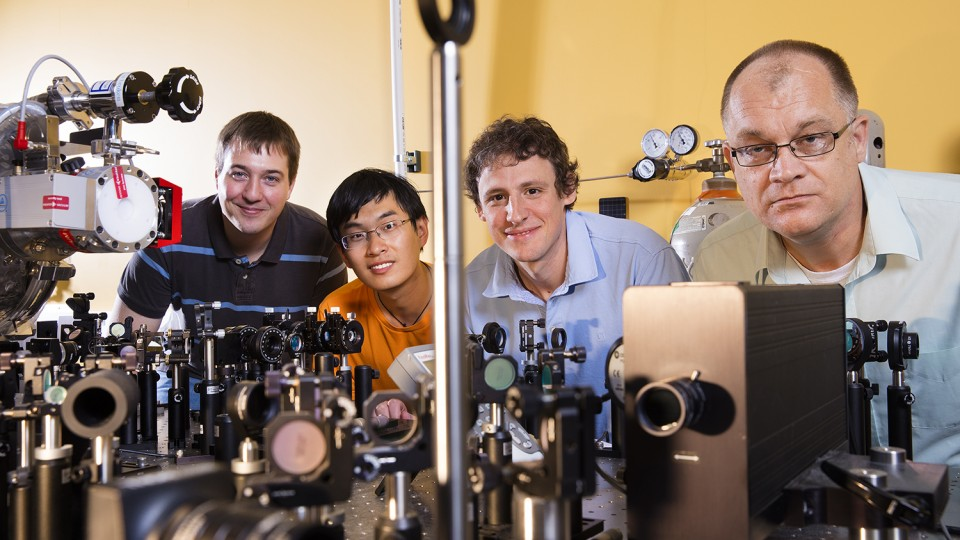 "From left, doctoral students Joshua Beck and Jie Yang with Martin Centurion and Cornelis ""Kees"" Uiterwaal, associate professors of physics and astronomy."