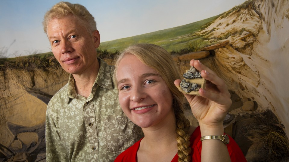 Carissa Raymond (right) holds fossilized teeth of a multituberculate mammal, a small rodent-like creature that lived at the end of the dinosaur's era. During summer 2014, Raymond found a similar fossil later identified as a previously unknown multituberculate species while on a dig in New Mexico. Ross Secord (left), associate professor of earth and atmospheric sciences, led the dig.