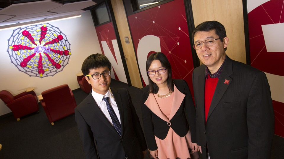 Researchers (from left) Chongqin Zhu, Yingying Huang and Xiao Cheng Zeng co-authored a study that has predicted the existence of a new form of ice.