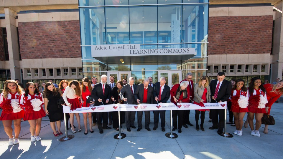 University administrators and project donors cut the ribbon during the March 28 dedication of UNL's Adele Coryell Hall Learning Commons. The 24-hour learning and study space opened for student use in January.