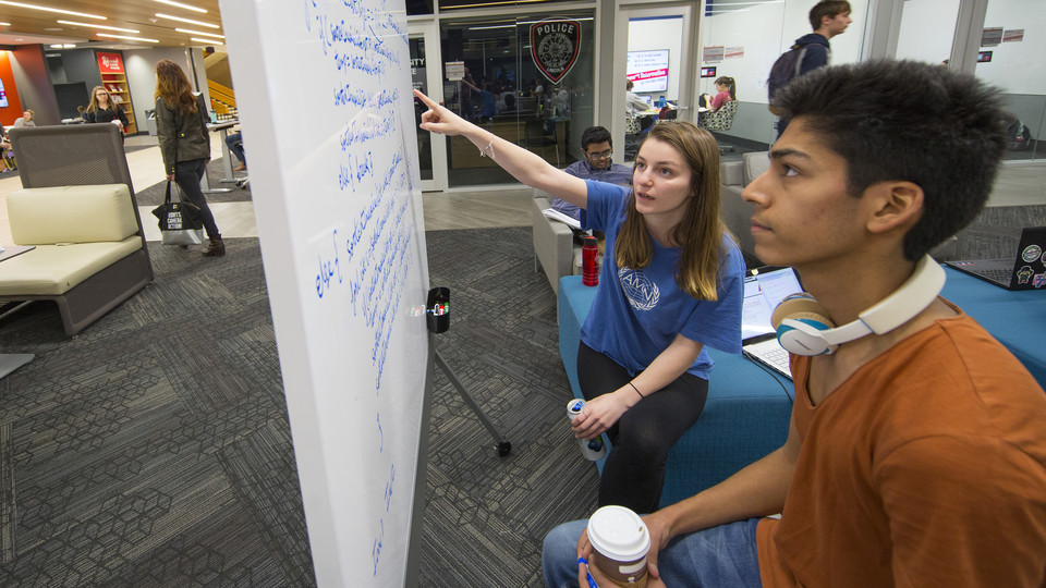 Students Pranav Gupta (right) and Ibra Kurti work on computer science coding in the Adele Hall Learning Commons