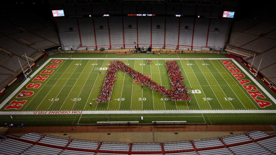 "Members of the University of Nebraska–Lincoln's freshman class line up in the shape of an ""N"" during the New Student Tunnel Walk on Aug. 27. For the second year, enrollment at the university has surged to an all-time high."