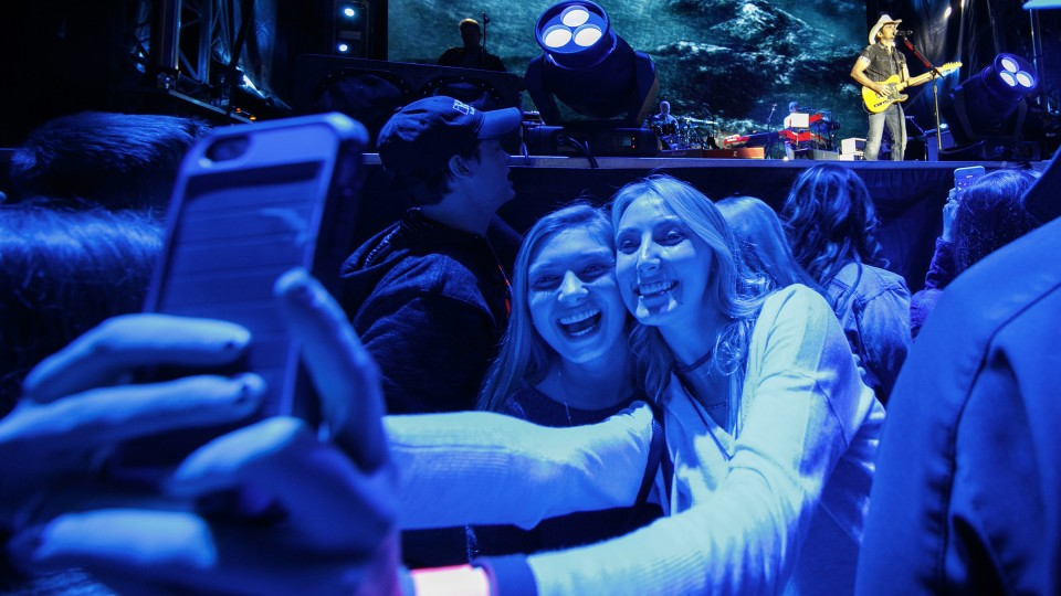 Nebraska students pose for a selfie as Brad Paisley plays on stage during a free Oct. 13 concert on City Campus. The concert drew thousands.