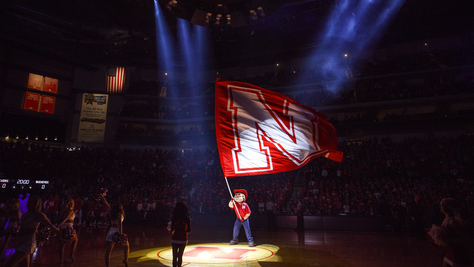 "Herbie Husker waves the ""N"" flag before Nebraska's player introductions."