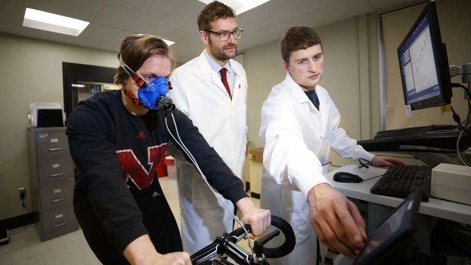 Karsten Koehler (center) works with students in his exercise science lab in Nebraska's Department of Nutrition and Health Sciences.