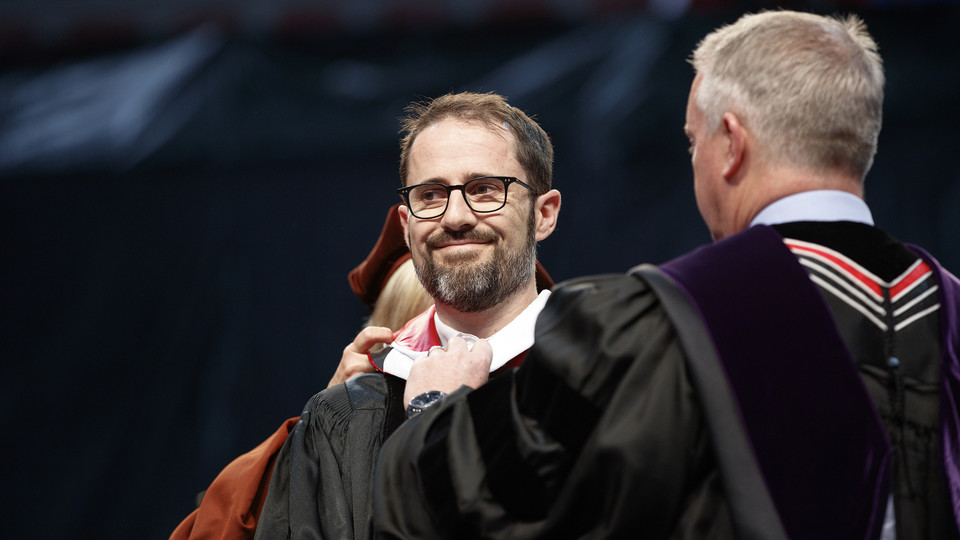 Evan Williams, Nebraska native and founder of Twitter, receives an honorary degree before he delivered the commencement address on May 6.