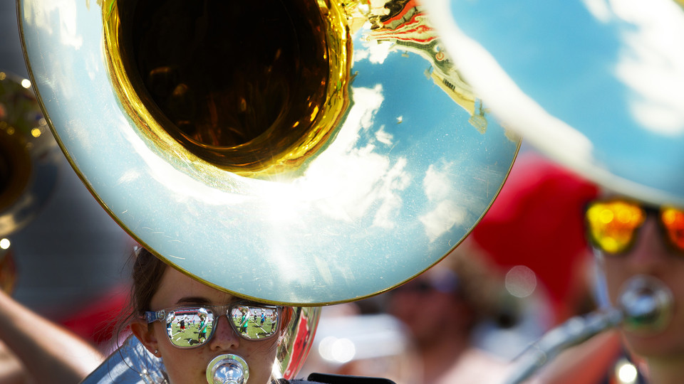A sousaphone play practices with the Cornhusker Marching Band in Memorial Stadium.