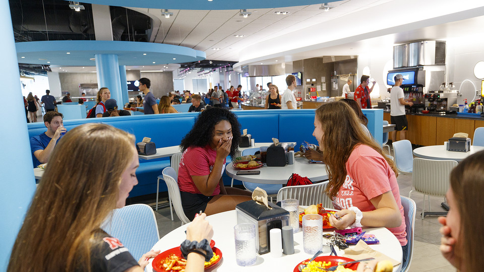 Huskers share a laugh as they eat in Nebraska's new Willa Cather Dining Complex. The dining center opened in summer 2017.