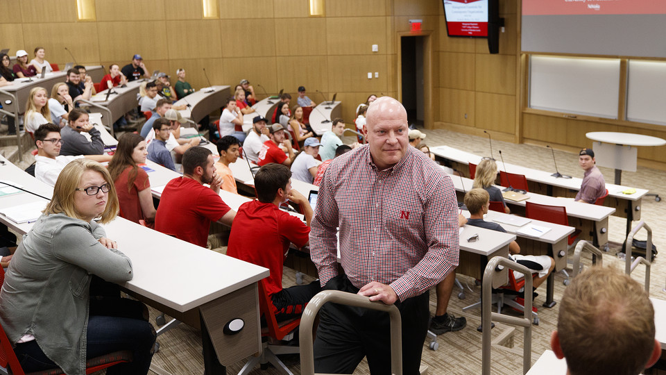 Business professor Kevin Wesley listens as students talk about their experience with managers during the first hour of Management 300 in the College of Business' new Howard L. Hawks Hall on Aug. 21.