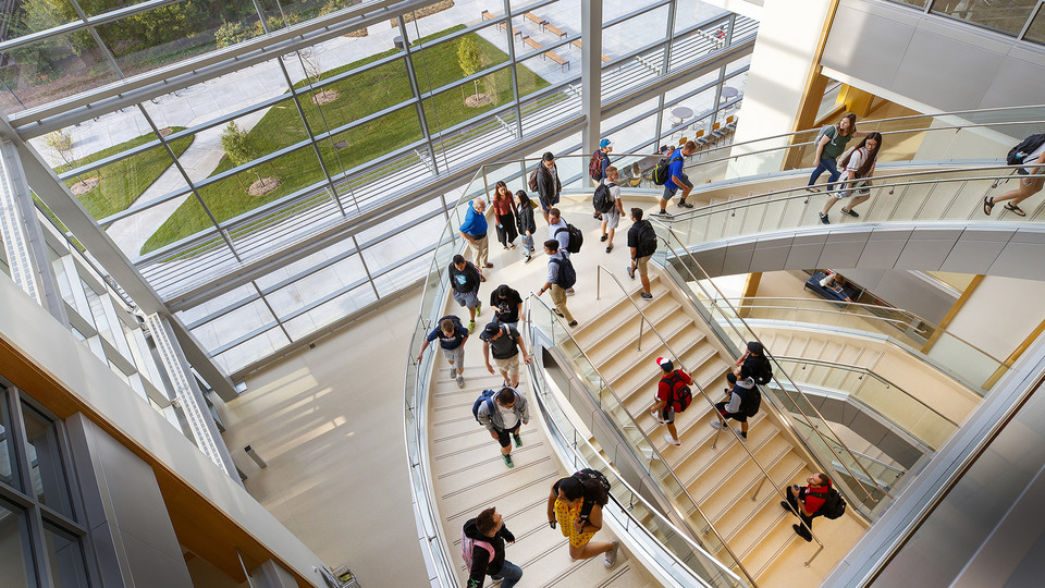 Students walk up the south staircase toward the third floor of the College of Business' new Howard L. Hawks Hall on the opening day of the fall semester.