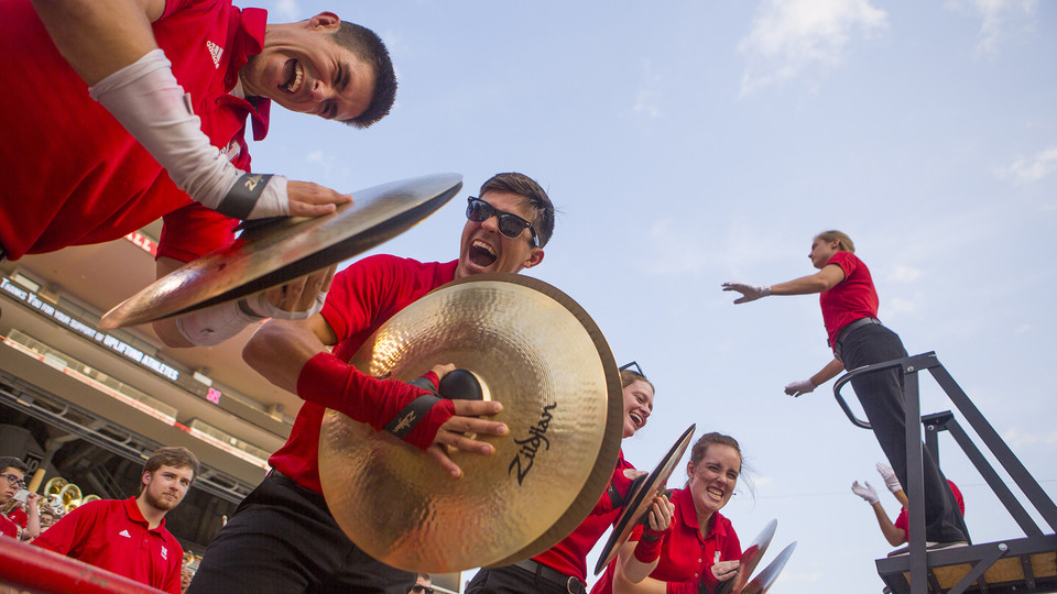 Cornhusker Marching Band cymbal players react during the Boneyard Bash in Memorial Stadium on Aug. 26.