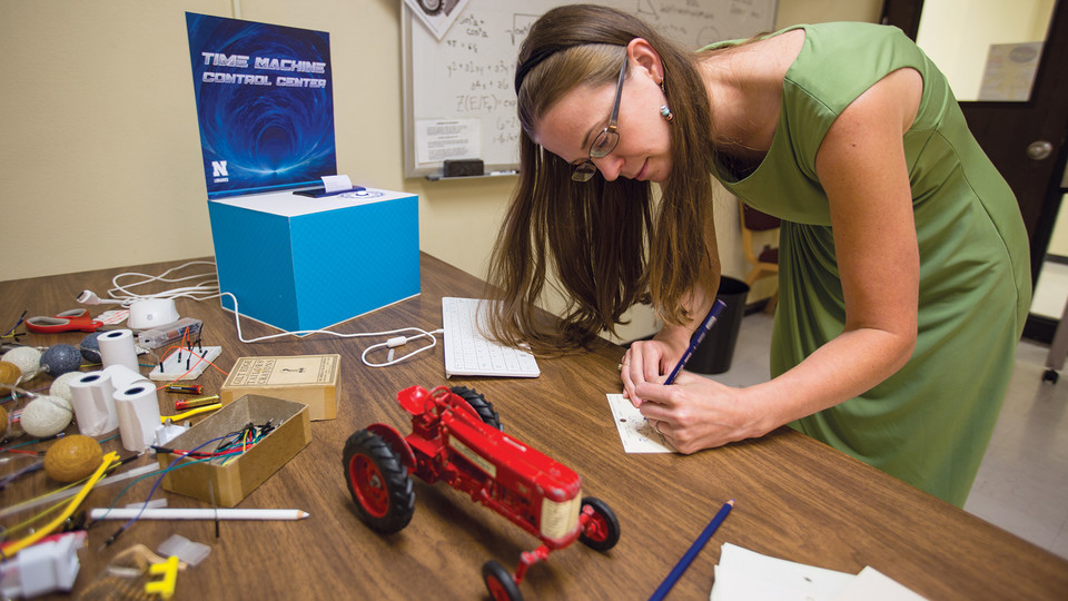 Jenny Thoegersen works on a puzzle in the C.Y. Thompson escape room on Aug. 28. The escape room, which will be open Aug. 30, was designed by Thoegersen and Erica DeFrain, both faculty in the University Libraries.