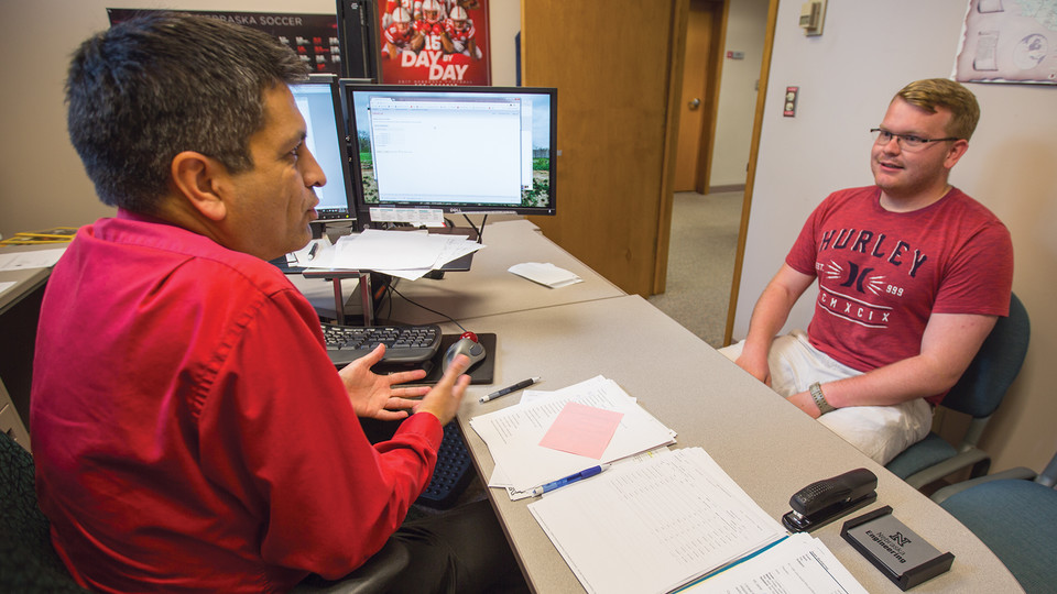 Ryan Green (right) meets with Juan Gutierrez, assistant registrar, on Aug. 30. Green received deployment orders on Aug. 30 and had a handful to days to prepare for departure.