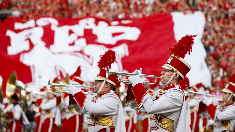 The Cornhusker Marching Band performs at the start of the Sept. 2 game with Arkansas State University. More than 30 members of the band are participating in the 22 in 22 Challenge, which is designed to raise awareness about veteran suicides and raise funds for veteran support services.