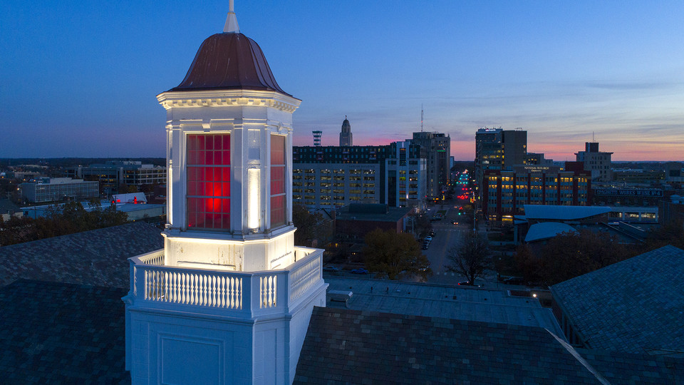 Love Library cupola glows red over downtown Lincoln as the sun sets to the west on Nov. 15.
