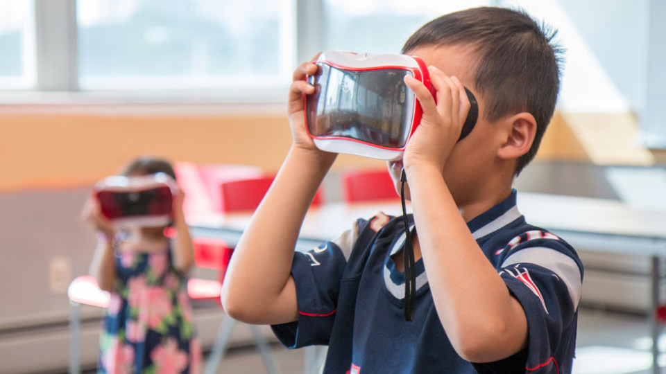 Children interact with a new Nebraska-developed virtual reality game that teaches children about nutrition and physical activity.