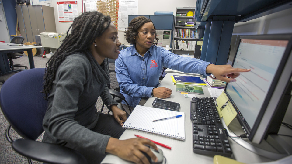 Nebraska's Terri Norton (right) works on a project with Lucy Ampaw Asiedu, a graduate student in architectural engineering.
