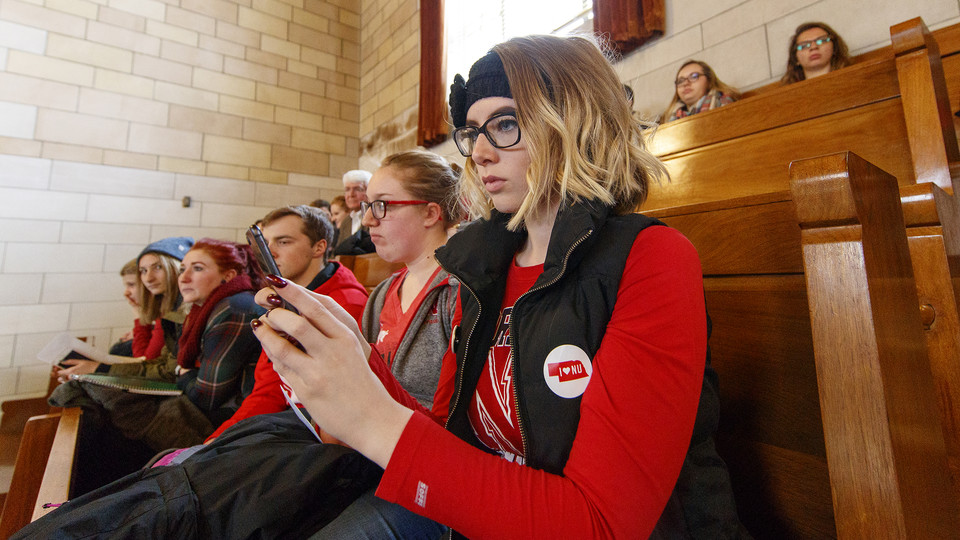 "Husker Tia Rasmussen takes a photo of the legislative session while attending the ""I Love NU"" Advocacy Day at the State Capitol in 2018. The event was attended by several hundred students, staff, faculty, alumni and friends of the NU system."