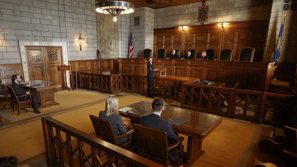 Nebraska Law student Maureen Larsen (center) makes a point before Nebraska Supreme Court Justices (from left) William B. Cassel, Michael G. Heavican and Stephanie Stacy during the 2018 Thomas Stinson Allen Moot Court Competition. The Nebraska Law program was recently counted among the nation's best in terms of graduates earning jobs.