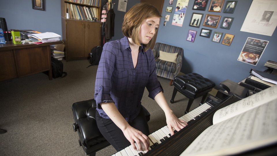 Moriah Hellstrom, a senior music major from Omaha, plays on the piano in Paul Barnes' studio in Westbrook Music Building. A May graduate, one of Hellstrom's final Nebraska experiences will be learning from world-renowned composer Philip Glass.