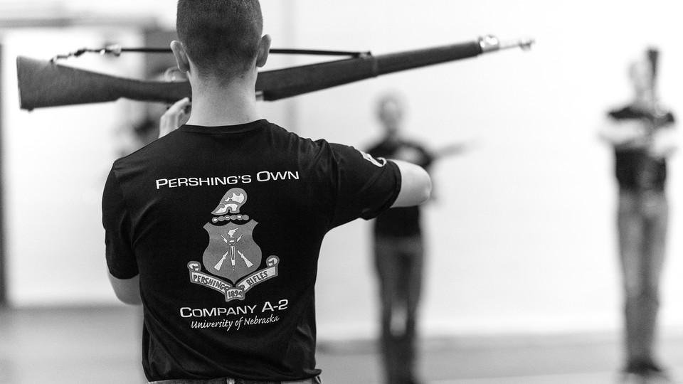 Air Force Cadet 3rd Class Zachary Day leads the group in warmups. Pershing Rifle drill team practices in the Pershing Military and Naval Science Building.  Student organization sponsored by ROTC.  April 17, 2019. Photo by Craig Chandler / University Communication