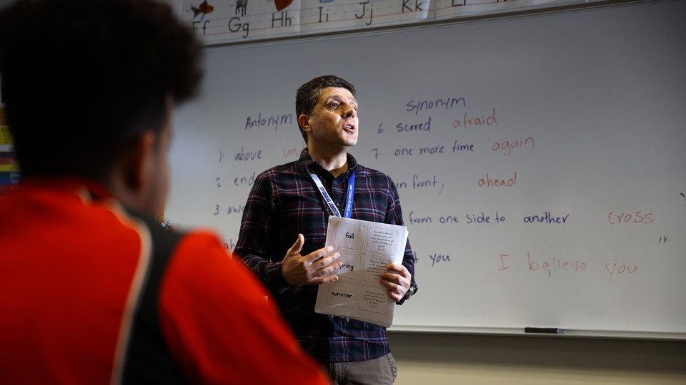 Hadi Pir teaches his class at Lincoln North Star High School