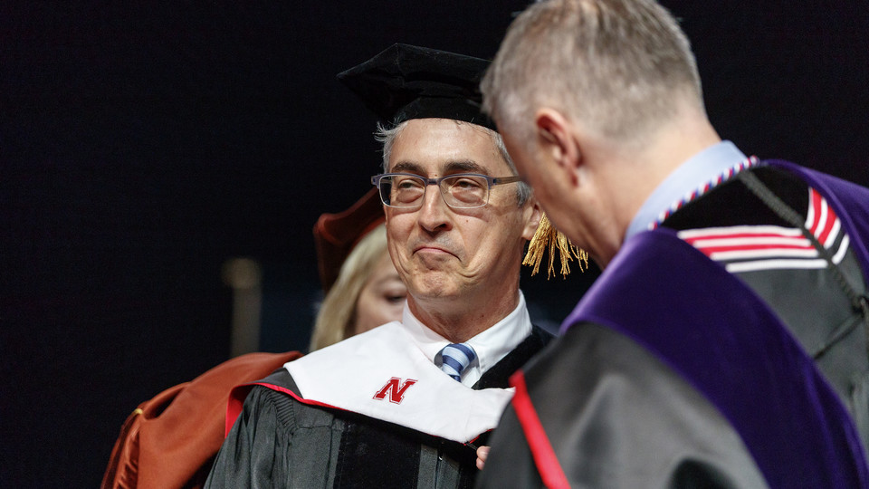 Film director Alexander Payne reacts while he was hooded when receiving an honorary doctorate degree during University of Nebraska–Lincoln commencement exercises on May 5.