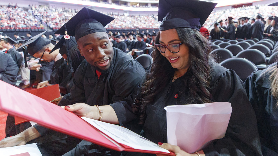 Nasan Altwal examines her diploma as she and Feedom Akinmoladun discuss graduation during commencement exercises on May 5. In case you missed it, Nebraska conferred a record 3,221 degrees during ceremonies on May 4 and 5.