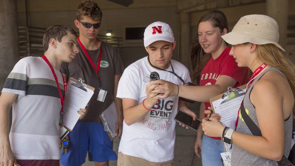 University of Nebraska-Lincoln student Maddy Diedrichsen (second from right) works with high school students on a microclimate project in Memorial Stadium June 14. The high school students attended Nebraska's National Weather Camp, June 10-15.