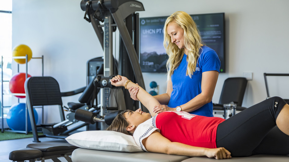 Jenny Meints, a licensed physical therapist assistant, works with a volunteer in the University Health Center's new physical therapy space. The facility includes a warm-water therapy pool, gym and private patient rooms.