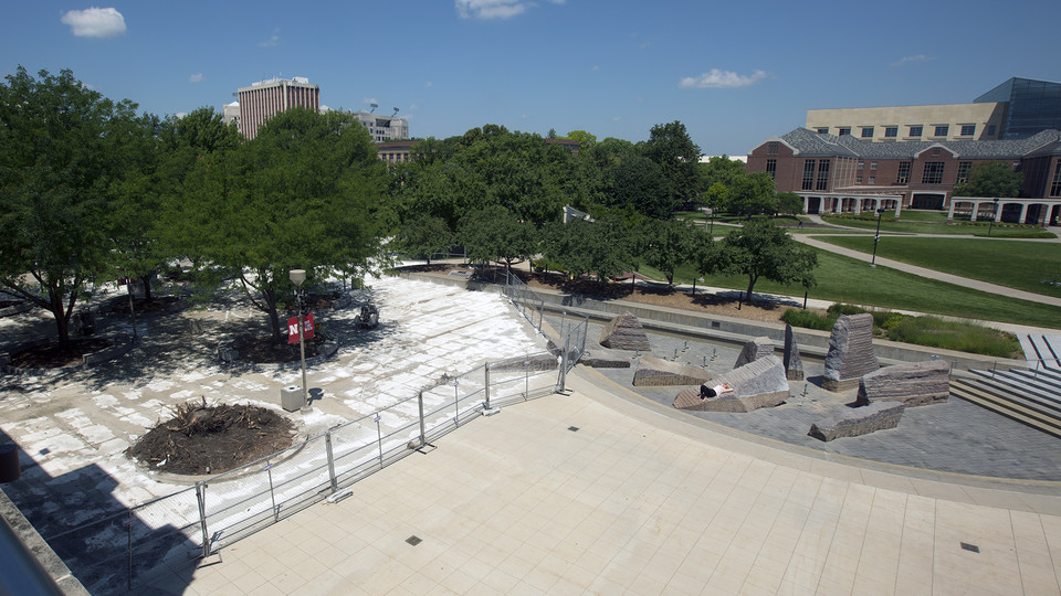 Fencing blocks off a concrete replacement project on the west third of the Nebraska Union Plaza. The work, which continues through mid-August, is the final phase in a three-year upgrade of the plaza.