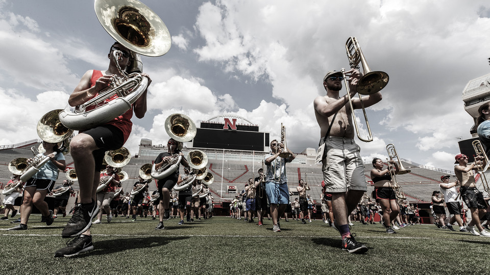 Members of the Cornhusker Marching Band practice on Tom Osborne Field in Memorial Stadium. The band's annual exhibition is Aug. 17.