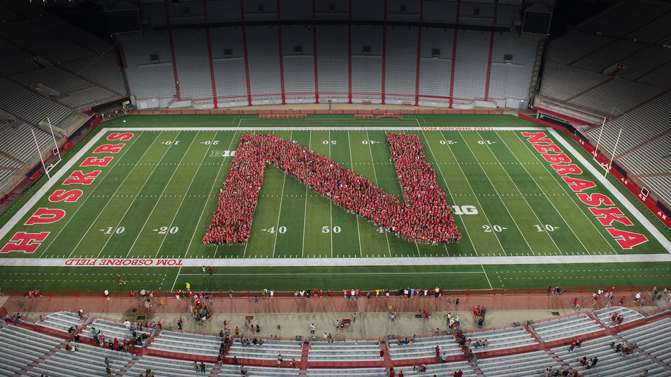"""Nebraska's 2018 freshman class celebrated the start of the new academic year by taking part in a tunnel walk and forming a Nebraska """"N"""" in Memorial Stadium on Aug. 24."""