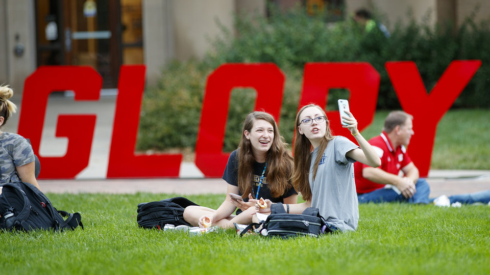 """Huskers (from left) Miranda Mueller and Miranda Hornung take a selfie while enjoying their lunches during the Aug. 31 """"In Our Grit, Our Glory"""" celebration on East Campus."""