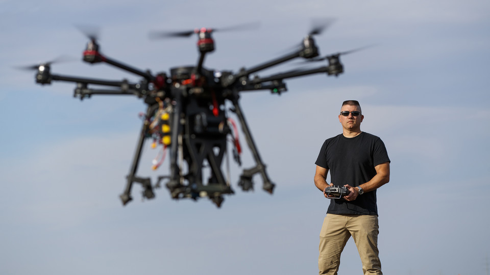Nebraska's Adam Plowcha pilots a drone that is being developed to drill holes and place sensors in soil. The vehicle has multiple applications, from agriculture to national defense.
