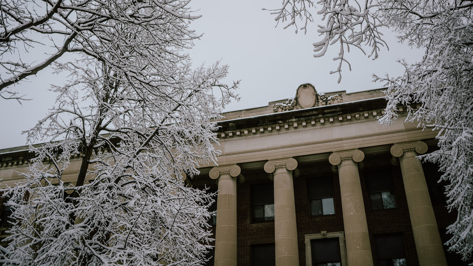 Louise Pound Hall is framed by snow covered branches following a storm on the weekend of Jan. 12-13. Learn more about how the university distributes weather-related closure announcements at http://bit.ly/2CyLSXO.