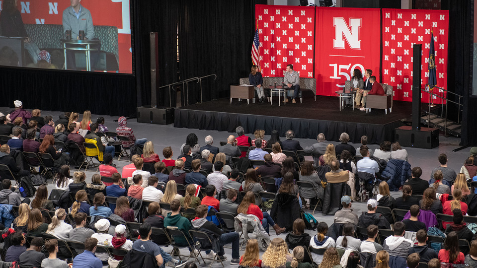 Students, faculty and staff listen to the panel discussion with Sen. Ben Sasse during a Charter Week event Feb. 11 at the Coliseum.