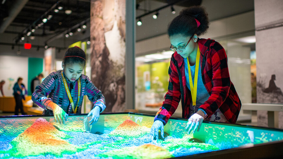 Visitors enjoy a preview visit to the new Cherish Nebraska exhibit in February 2019.