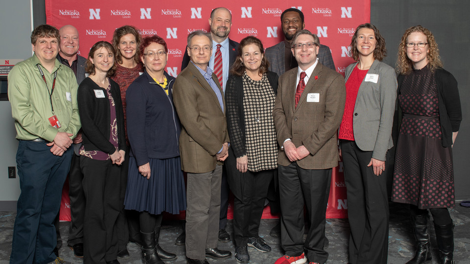 A group of Nebraska faculty and staff pose for a photo during the Parents' Association awards.