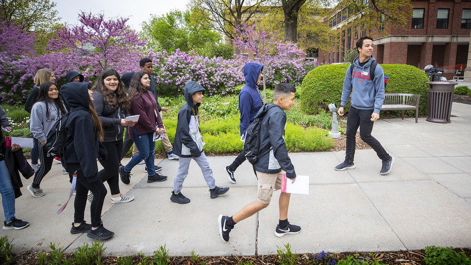 Michael Litton leads a group of Lexington middle schools students on a tour of campus in early May. Due to demand from the public, Nebraska Admissions has started to offer a variety of programs directed at middle school students interested in knowing more about college.