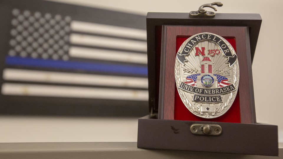 The University Police Department is celebrating the 150th anniversary of the university with a new badge that features the Love Library cupola and N150 logo. The badges, paid for by the Nebraska Fraternal Order of Police, feature two colors — silver for officers, gold for department leadership — and are being worn by commissioned officers.