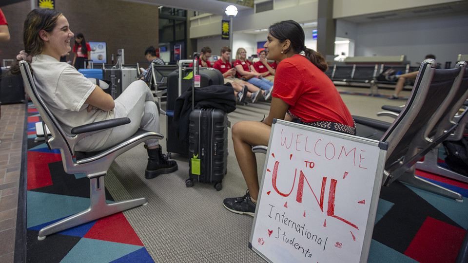 Shridula Hegde (right) talks with Katie Brooks during international student welcome activities on Aug. 19 at the Lincoln Airport. Though it meant a longer flight, Brooks landed in Lincoln to take advantage of Nebraska's enhanced welcome activities for students from abroad.