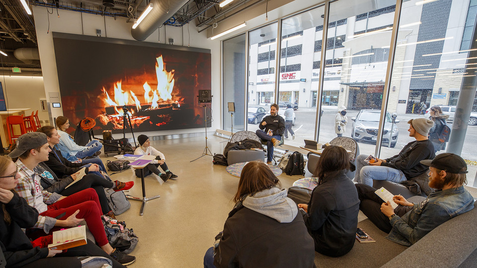With a fireplace in the background, faculty Jesse Fleming leads a discussion in a Visual Expression Studio course in Nebraska's Johnny Carson Center for Emerging Media Arts. The facility, which is in its first semester of use, will be celebrated Nov. 15-17.