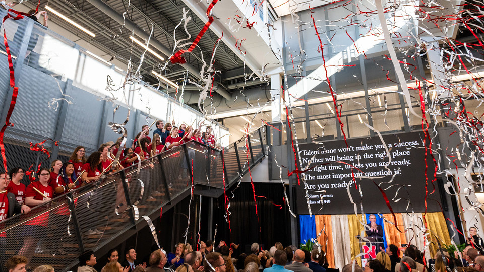 Carson Center students launch confetti from the stairs of the new facility during the Nov. 16 grand opening celebration.