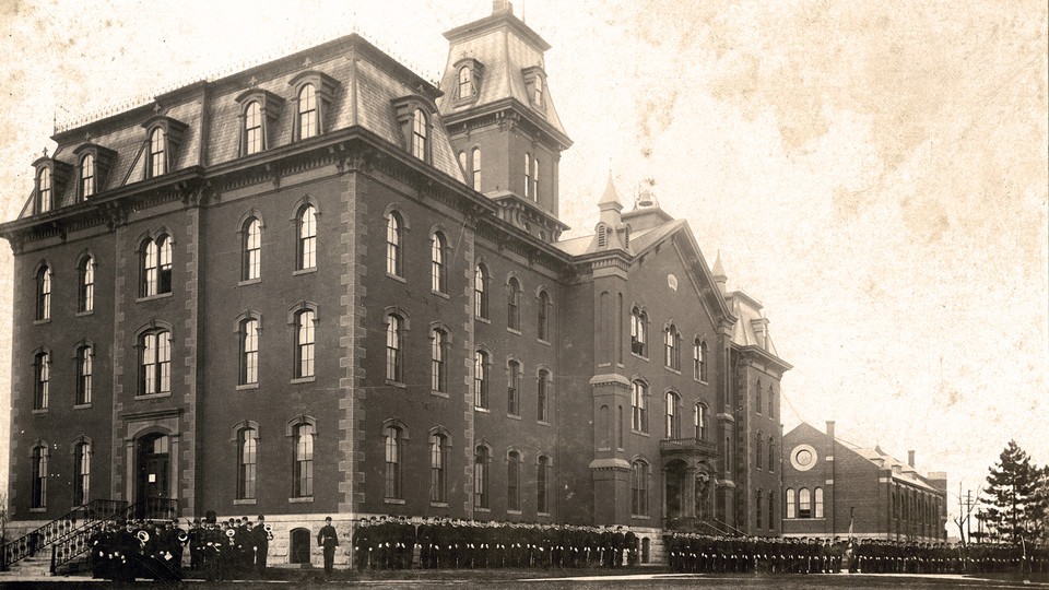 Military cadets line up outside University Hall, the first building on campus, in this undated photo. The history of the first buildings on campus is the focus of the Feb. 12 Nebraska Lecture.