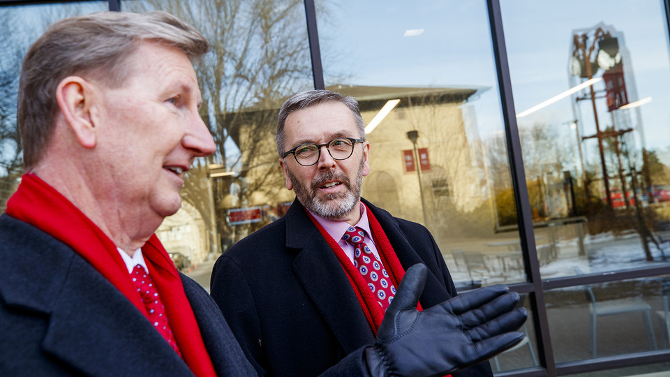 Ted Carter (left) and Ronnie Green talk outside of the East Campus Union during tour activities on Jan. 16.