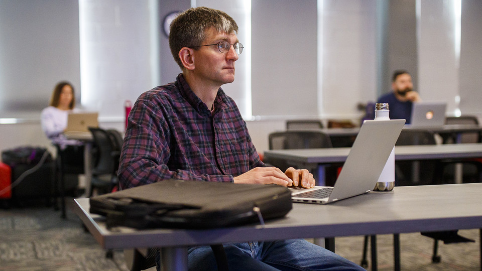 Chad Brassil, associate professor of biological sciences, listens as instructional designers from the Center for Transformative Teaching present ideas for a smooth transition to remote learning during a March 17 session. The center is offering a one-week, spring break course to help instructors overcome remote teaching challenges. Learn more at https://go.unl.edu/rm4z.