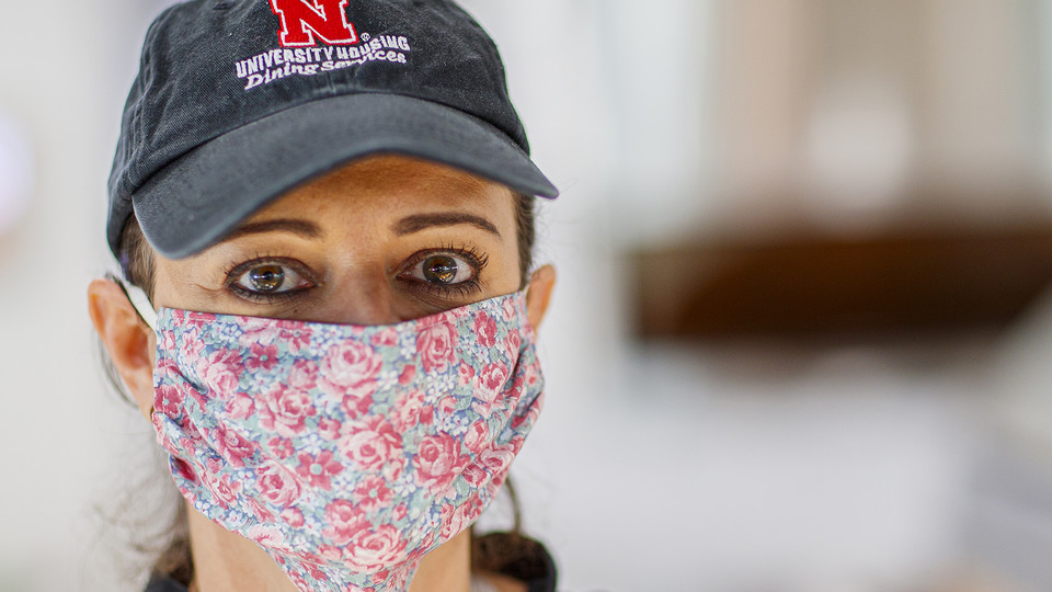 Simone Bilha, a dining service team leader in the Willa Cather Dining Center, wears a homemade cloth mask as she works on April 7. The university is seeking the donation of more than 1,000 homemade masks for essential employees. The masks will help increase safety for workers who continue to serve the campus community.