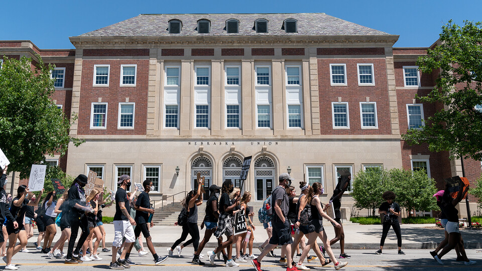 Protestors walk past the south entrance of the Nebraska Union during a march to the Nebraska State Capitol on June 13, 2020. A new course offered in the College of Journalism and Mass Communications is exploring what it's like being Black and living in Lincoln.