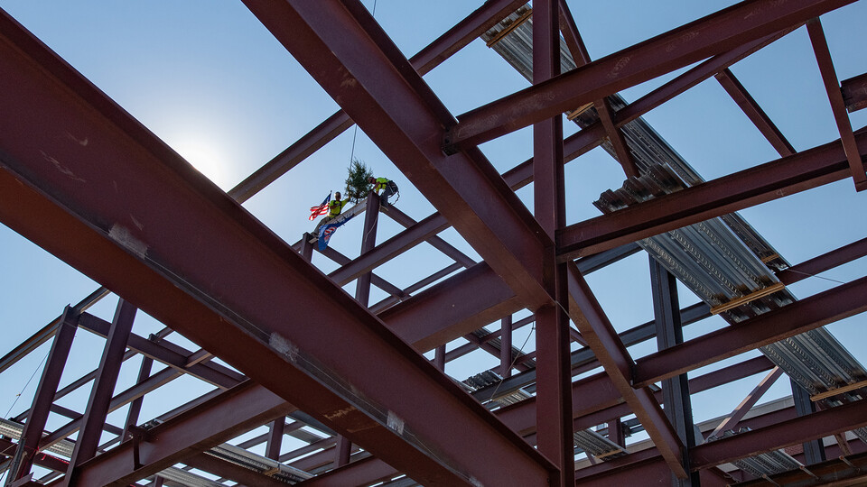Hausmann Construction workers complete the installation of the final beam in the first phase expansion of College of Engineering facilities on Aug. 26.